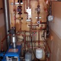 "Upgrades: ""Super Hot"" boiler replaced a ""Teledyne Lars"" boiler for a Poly-B radiant in-floor heating system"