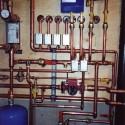 Upgrades: Radiant in-floor heating system with Poly-B (grey) tubing upgraded to a computerized system